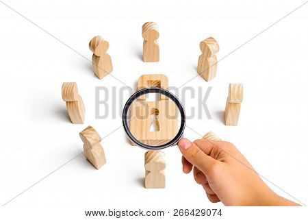 Wooden Figures Of People Surround The Padlock. Concept Of Protection Of Personal Data Trade Secrets,