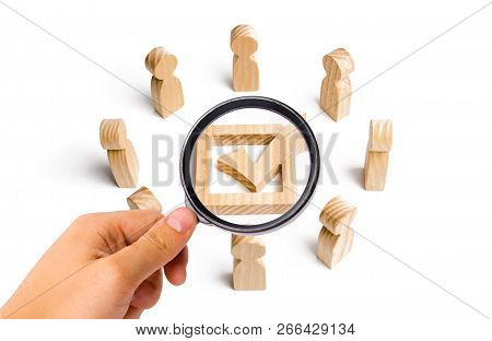 People stand in a circle and look at the check mark in the box. election, poll or referendum. Poll people. Voters participate in elections of parliament or president, teamwork. Selective focus poster