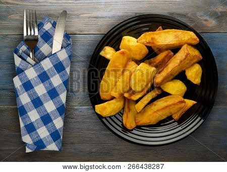 Fry Potatoes On A Wooden Background. Fry Potatoes On A Plate