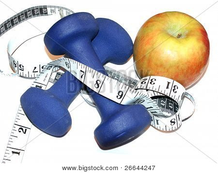 Dumbbells with apple and measuring tape