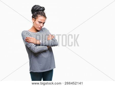 Young braided hair african american girl wearing sweater over isolated background skeptic and nervous, disapproving expression on face with crossed arms. Negative person. poster