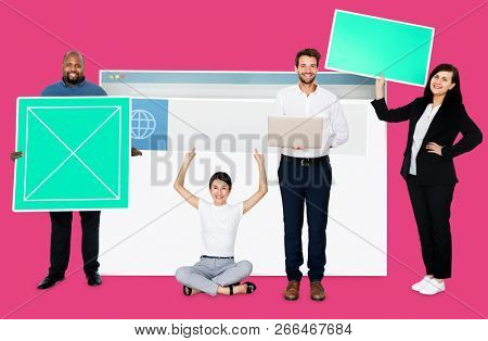Happy diverse people holding a web design