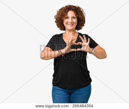 Beautiful middle ager senior woman over isolated background smiling in love showing heart symbol and shape with hands. Romantic concept.