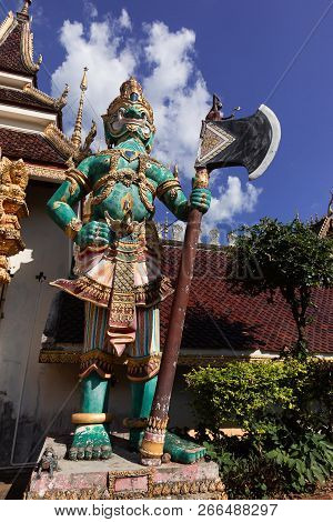 Giant Statue Standing In Front Of The Thailand Temple.buddhist Believe That The Giant To Defend The