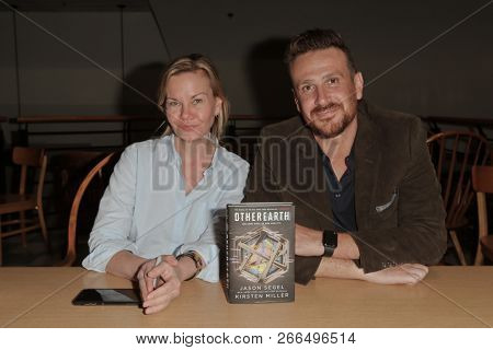 HUNTINGTON, NY - OCT 30: Actor Jason Segel (R) and co-author Kirsten Miller autograph copies of