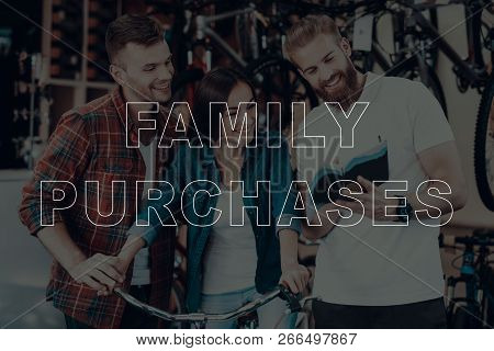 Family Purchases. Customers Choosing A Bicycle. Salesman Showing Bicycle To Customers. Customers Is