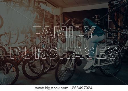 Family Purchases. Customer Choosing A Bicycle. Salesman Showing Bicycle To Customer. Customer Is You