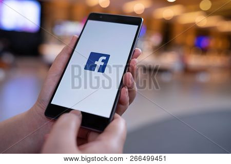 Chiang Mai, Thailand - August 03,2018: Woman Holding Huawei With Facebook App On The Screen. Faceboo
