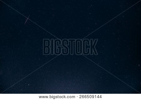Natural Night Starry Sky. Glowing Stars And Meteoric Tracks Trail In Dark Night Starry Sky Backgroun
