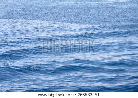 Blue Sea Water With Ripples Surface. Rippled Water Texture. Breezy Seaside Landscape. Fresh Clean Wa