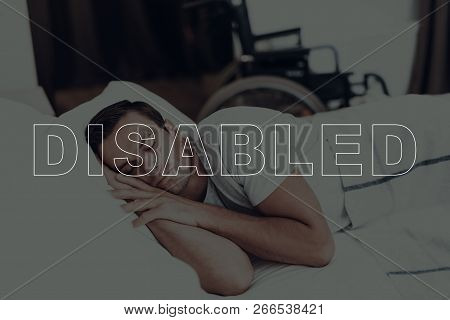 Disabled Man. Man Is Lying In Bed. Man Is Relaxing And Sleeping. Adult Caucasian Brunette Man. Man L