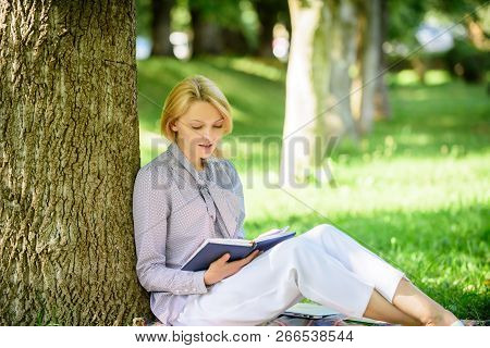 Books Every Girl Should Read. Girl Concentrated Sit Park Lean Tree Trunk Read Book. Reading Inspirin
