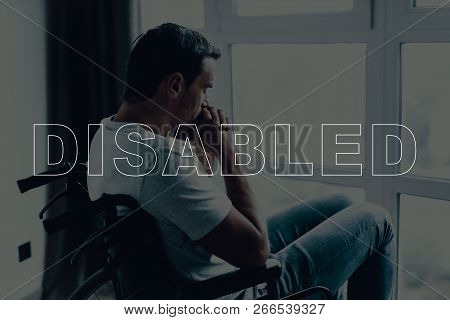 Disabled Man In A Wheelchair. Man Sitting In Front Of Window. Large Panoramic Window. Man Is Praying