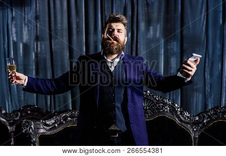 Handsome Man Businessman In Suit. Boss Drink Alcohol In The Glass And Enjoys The Success. The Concep