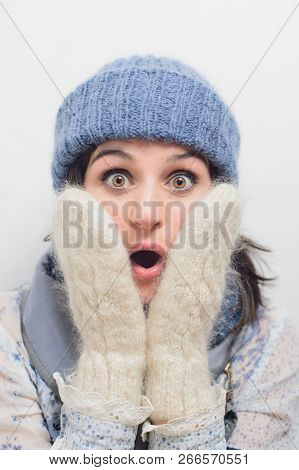Close Up Portrait Of Shocked Young Woman Face. Adult Girl In Winter Clothes. Wow, Omg, Secret, Horro