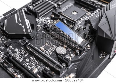 Hard disk SSD m2 on the motherboard background. Hard disk SSD m2 on the motherboard background. M2 technology can develop the speed of reading and writing information up to 3500 mbs. poster