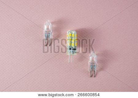 G4 Bipin Lamps Two Halogen And One Modern Eco Led Type Arranged Diagonally On A Pink Background Show