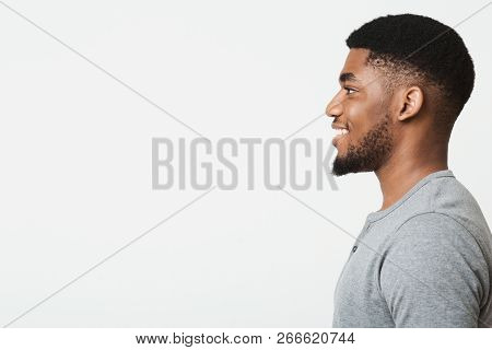 Happy Smiling African-american Man Profile Portrait. Black Guy Looking Aside At Copy Space