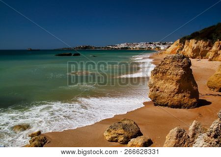View Of Coast And Cliffs In Albufeira, District Faro, Algarve, Southern Portugal