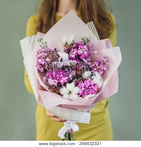 Colorful Bouquet Of Different Fresh Flowers In The Hands Of Florist Woman. Rustic Flower Background.