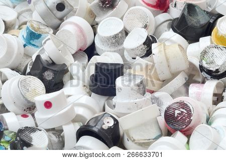 A Pattern Of Many Used And Soiled Nozzles From Spray Cans With Aerosol Paint. Background Texture Of