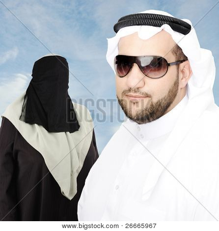 Smiling young man with his woman, arabic traditional clothes