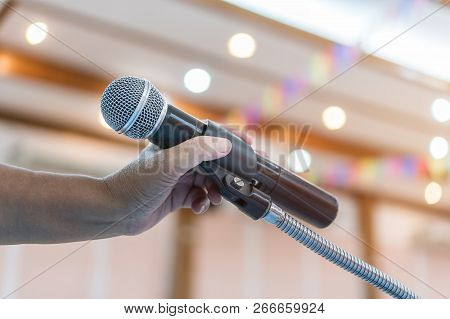 Speaker Holding Microphone For Speak, Presentation On Stage In Public Conference Seminar Room. Busin