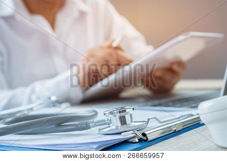 Healthcare Medical Concept, Hands Doctor's Writing And Working By Stylus For Order Medication On Tab