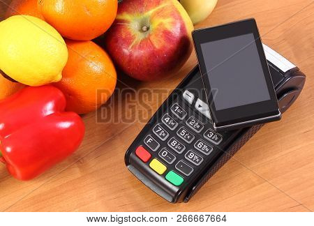 Payment Terminal, Credit Card Reader With Smartphone With Nfc Technology And Fresh Fruits And Vegeta