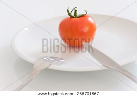 Vegan Diet Concept With Only One Tomato In A Dish