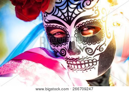 Woman Wearing Skull Mask And Paper Flowers For Dia De Los Muertos/day Of The Dead