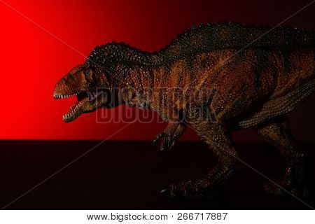 Acrocanthosaurus With Spot Light On The Head And Red Light On Background No Logo And No Trademark