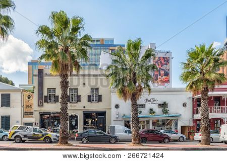 Cape Town, South Africa, August 17, 2018: A Street Scene, With Businesses, Vehicles And Palm Trees,