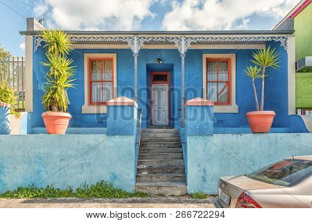 Cape Town, South Africa, August 17, 2018: A Blue-colored House With Orange Windows, In The Bo-kaap I