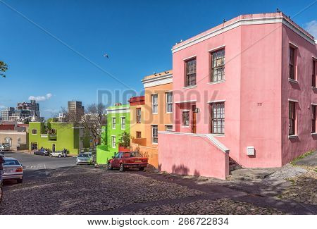 Cape Town, South Africa, August 17, 2018: A Street Scene, With Multi-colored Houses And Vehicles, In