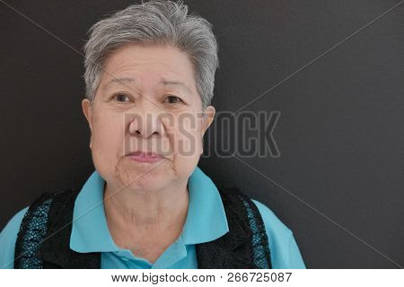 Happy Old Elderly Elder Senior Woman Smiling With Happiness Near Black Wall