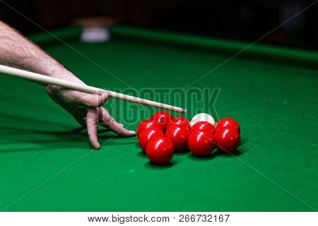 Man Trying To Hit The Ball In Snooker. Shallow Focus.