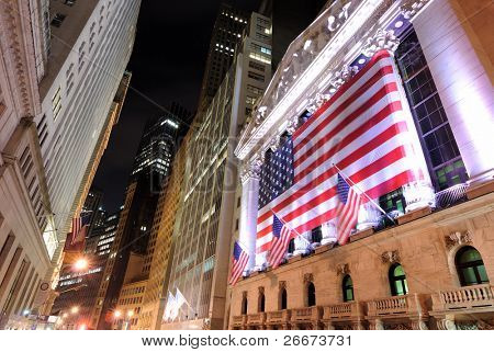 NEW YORK CITY - JUNE 16: Wall Street at night with the New York Stock Exchange June 16, 2010 in New York, New York.