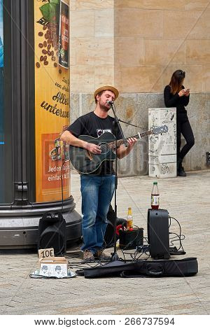 Leipzig, Germany - October 06, 2018: Singing Street Musician In The City Center Of Leipzig In German
