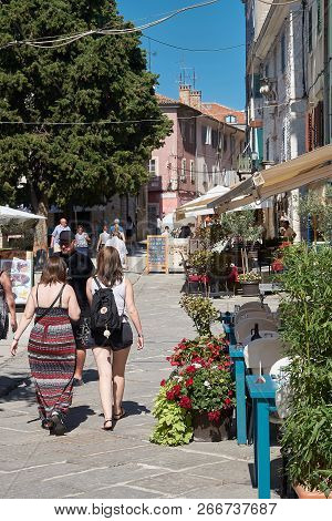 Porec, Croatia - July 20, 2018: Tourists Taking A Walk Through The Historic Old Town Of Porec In Ist