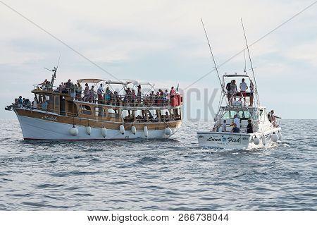 Porec, Croatia - July 22, 2018: Tourists On Excursion Boats Off The Coast Of Porec In Croatia In Sea