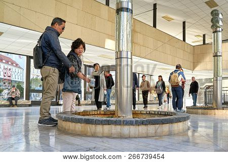 Karlovy Vary, Czech Republic - September 30, 2018: Tourists On A Fountain In The Thermal Spring Colo