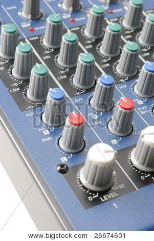 A mixing board on a preamp for amplifying audio signal in a recording studio.