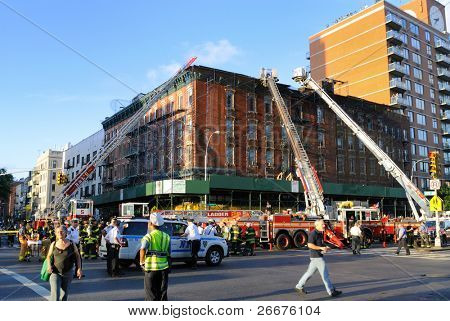 NEW YORK CITY - JULY 8: A crew of firefighters responds to a fire on Houston Street in the Lower East Side July 8, 2010 in New York, New York.