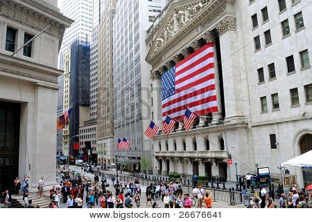 NEW YORK CITY - MAY 27: The historic New York Stock Exchange on Wall Street with crowds below, one of the largest stock exchanges in the world May 27, 2010 in New York, New York.