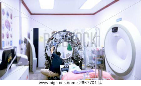 Maintenance Engineer Repairing And Checking Ct Scanner Machine Every 3 Month In The Hospital. Servic