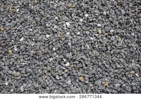 Grey Gravel Closeup Photo For Background. Sharp Gray Stones For Construction. Gravel Texture. Road O