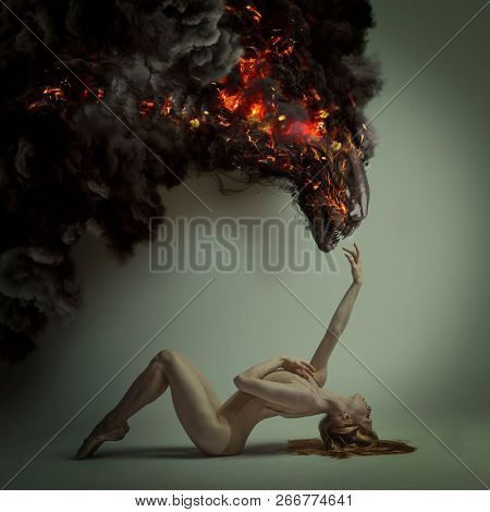 duality and danger concept, classic ballet dancer lying down with elegant and delicate poses and a fiery monster over in menacing pose, halloween