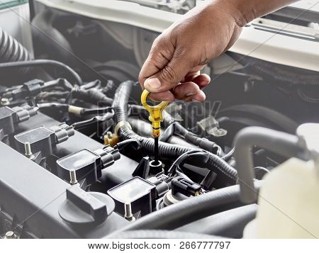 Technician Hand Opening The Car Oil Tank Lid For Checking, Repair Or Changing New Oil In Garage At C