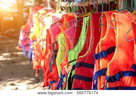 Life Jacket Orange Color Hanging On Row. Life Jackets, Safety Equipment Prevent Drowning. Life Secur